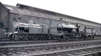 Caledonian Railway 4-2-2 'Single' no 123 poses with LNWR 2-4-0 'Precedent' no 790 <I>Hardwicke</I> alongside Kingmoor shed on 30 August 1958. [See image 33618]<br><br>[K A Gray&nbsp;30/08/1958]
