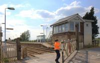 Heather closing the level crossing gate at Shippea Hill in May 2011.<br><br>[Ian Dinmore&nbsp;/05/2011]