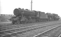 A pair of WD <I>Austerity</I> 2-8-0s on Wakefield shed on a grey March morning in 1961. Nearest the camera is no 90651, a 1944 product of the Vulcan Foundry, finally withdrawn from here in October 1966.<br><br>[K A Gray&nbsp;12/03/1961]
