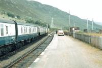 Collecting the mail off the train from Inverness at Helmsdale in 1980. [See image 35626]<br><br>[Ian Dinmore&nbsp;//1980]
