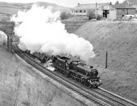 Preserved Black 5 No. 45407 and A3 <I>Flying Scotsman</I> dig in on the ascent of Lindal Bank, while working a railtour between Carnforth and Sellafield in May 1977. Taken at Rowe Head, about a mile and a half west of Ulverston.<br><br>[Bill Jamieson&nbsp;07/05/1977]