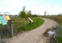The closed walkway at Hardengreen on 10 May 2013. View north, with work taking place towards what will become the site of the new Eskbank station, once the filled-in cutting has been re-excavated. The Tesco Hardengreen Superstore is in the left background.<br><br>[John Furnevel&nbsp;10/05/2013]