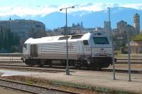 Stabled in the sidings adjacent to the platforms at Granada on 1 May is a RENFE class 334 Bo-Bo diesel electric locomotive. The snowcapped Sierra Nevada mountains form the backdrop.<br><br>[Andrew Wilson&nbsp;01/05/2013]