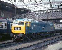 On 4th September 1976 Carlisle Diesel Depot hosted an open day, although whether ex-works 47141 had been stabled in a prominent position for the benefit of enthusiasts arriving by train I cannot say. With the station clock showing just after 11.30, the morning Leeds to Glasgow train waits to continue its journey northwards.<br><br>[Bill Jamieson&nbsp;04/09/1976]