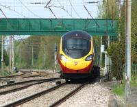 A southbound Pendolino negotiates the switchback that is the WCML at Euxton on 11 May 2013. The telephoto lens makes the track look more undulating than it really is. The ride is in fact surprisingly smooth, even at 110 mph plus.<br><br>[John McIntyre&nbsp;11/05/2013]