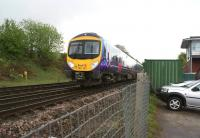 TransPennine 185121 heads west passed Chinley North Junction and signal box with a train to Manchester Airport on a wet and miserable 12 May 2013.<br><br>[John McIntyre&nbsp;12/05/2013]