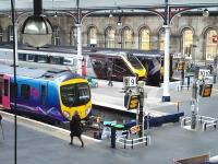 The west end bay platforms at Newcastle Central on 8 May. A TransPennine 185 unit forms the 17.02 to Manchester Airport at no 9, a CrossCountry Voyager stands at 11 with the 17.32 to Guildford, while ScotRail's 156494 is at platform 12 with the 17.16 to Glasgow Central via Dumfries.<br><br>[David Pesterfield&nbsp;08/05/2013]