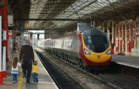 A Birmingham bound Pendolino leaving platform 4 at Preston on 23 April 2013 as two young enthusiasts head away having been shown the pair of Black 5s on the <i>Great Britain VI</i> railtour out of the shot to the left.<br><br>[John McIntyre&nbsp;23/04/2013]