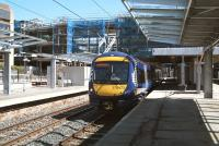The changing face of Haymarket. View west on 17 May 2013 as the East Coast 09.52 Aberdeen - London Kings Cross HST runs into platform 1. <br><br>[John Furnevel&nbsp;/05/2013]