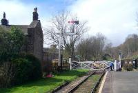 Closing the level crossing gates at Oakwaorth, April 2013.<br><br>[Colin Alexander&nbsp;27/04/2013]
