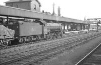 An up goods trundles south through Doncaster in the summer of 1961 behind Class O2 2-8-0 no 63969.<br><br>[K A Gray&nbsp;08/07/1961]