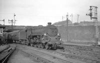 Caprotti standard class 5 no 73154 arriving at Buchanan Street in the Summer of 1965 with train from Dundee.<br><br>[K A Gray&nbsp;//1965]