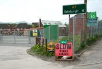 Entrance to the planned station and car park at Newtongrange on 22 May 2013. The A7 continues north along Murderdean Road (right) to cross the bridge over the trackbed, from which ramped access to the platform will also be available.<br><br>[John Furnevel&nbsp;22/05/2013]