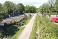 View north from the B6392 road bridge towards Glenesk Junction in May 2013, with the site of Glenesk Colliery and sidings on the left. Near the green barrier stood Glenesk station, which first appeared in timetables in 1855 (although its opening date is shown by both Butt and Cobb as 1858). The station (occasionally shown as Glenesk Junction) seems to have officially closed in 1874, though it continued in use (unadvertised) into the 1880s.<br><br>[John Furnevel&nbsp;22/05/2013]