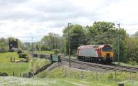 De-branded <I>Thunderbird</I> 57308, formerly known as <I>Tin Tin</I>, seen on a light engine movement from Crewe to Oxenholme passing Bay Horse on Friday 24th May 2013. The Class 57 is now owned by DRS but has not yet been repainted from its Virgin livery. <br><br>[Mark Bartlett 24/05/2013]