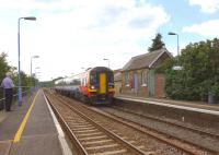 An East Midlands 158 passing through Lakenheath, Suffolk, in May 2011.<br><br>[Ian Dinmore&nbsp;21/05/2011]