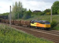 Colas Rail Freight 56302 hauls 17 loaded timber wagons from Carlisle to Chirk on 24 May 2013 just south of Farington Curve Junction on the WCML.<br><br>[John McIntyre&nbsp;24/05/2013]