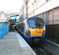 The 13.07 service to Milngavie boarding at  Waverley platform 8 on 17 May 2013. <br><br>[John Furnevel&nbsp;17/05/2013]
