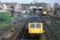 A full house at Lowestoft on 16th May 1981, with a Norwich service departing, an Ipswich service boarding and Class 31 and 08 locos in the sidings. The sadly missed overall roof lasted until 1992 [see image 43037]. Platform 1 (far left) fell into disuse after the line to Yarmouth South Town closed in 1970.<br><br>[Mark Dufton&nbsp;16/05/1981]