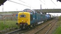 Deltic D9000 <I>Royal Scots Grey</I> leaves Barassie sidings on 4 May 2013 with the Kilmarnock Works to Glasgow Works EMU drag transferring unit 334025.<br><br>[Ken Browne&nbsp;04/05/2013]