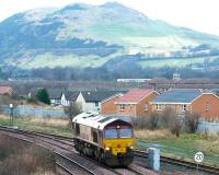 EWS 66111 running light engine takes the line towards Millerhill Yard at Niddrie West Junction in January 2003. Arthur's Seat dominates the background. <br><br>[John Furnevel&nbsp;12/01/2003]