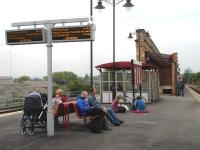 Compared to the canopy installed along the full operational length of platform 1 at Wakefield Kirkgate the re-ordered island platform 2 & 3 has been left rather sparsely appointed. Scene on the afternoon of 20 May 2013.<br><br>[David Pesterfield&nbsp;20/05/2013]