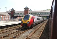 A Virgin Voyager stands on the up main line at Bangor on 29 May 2013 having arrived earlier with the 0810 from London Euston. It will soon move into the adjacent up platform and form the 1224 back to Euston.<br><br>[John McIntyre&nbsp;29/05/2013]
