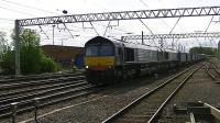 DRS 66302+66426 head 4S43 a very long 'Tesco Express' into and through Carlisle heading for Mossend<br><br>[Ken Browne&nbsp;22/05/2013]