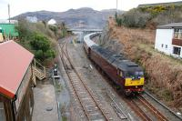 The Royal Scotsman leaves Kyle passing the recently renovated signalbox (museum and holiday accommodation).<br><br>[Ewan Crawford&nbsp;27/04/2013]