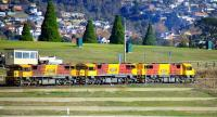 The only railway remnants in Hobart are a container yard and a general yard. Here, a trio of locos delivered in 2012 (the first new to Tasrail since 1973) depart after shunting the container yard. There is a grandstand just off camera for viewing yacht racing, with grass terraces for spectators. The unfenced rail line runs right through these terraces!<br> <br><br>[Colin Miller&nbsp;15/05/2013]