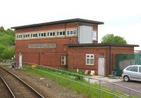 The signal box at Wigan Wallgate, standing between the lines to Southport and Crosby just west of the WCML. Photographed in May 2013 from a passing Southport to Wigan train.<br><br>[John McIntyre&nbsp;29/05/2013]