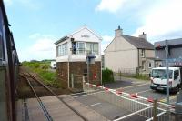 Passing Gaerwen SB, Anglesey, on a westbound train in May 2013. This was the junction of the branch to Amlwch and although the track is still in place on the branch, the old connection to the mainline (just beyond the SB) has been removed. Gaerwen station, closed in 1966, also stood here.<br><br>[John McIntyre&nbsp;29/05/2013]