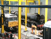 General view over the workshops at the National Railway Museum in June 2013. The locomotive hiding at the back, disguised in wartime black livery and carrying the number 502 is <I>Flying Scotsman</I>. [See image 26937]  <br><br>[John Furnevel&nbsp;06/06/2013]