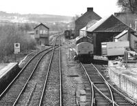 View south from the footbridge at Dingwall on 31 March 1989.  37417 <I>Highland Region</I> is receiving attention in the former goods yard while a Mk1 coach and 156 unit are stabled beyond.  Taken during the isolated operation of the Far North line due to collapse of the Ness Viaduct.<br><br>[Bill Roberton&nbsp;31/03/1989]