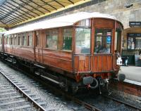 The unique ex-GNR teak Invalid Saloon no 3087, built at Doncaster in 1909. The coach was modified in more recent times to incorporate an 'observation end'. The vehicle is seen here on the rear of a NYMR train leaving Pickering for Grosmont in June 2013.<br><br>[John Furnevel&nbsp;01/06/2013]