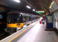 A Heathrow Express ready to depart for Paddington from Heathrow Terminal 3 on 1 June 2013.<br><br>[Ken Strachan&nbsp;01/06/2013]