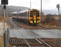 A Kyle to Inverness Sprinter service approaching Strathcarron on a wet and overcast 14 March 2013.<br><br>[Brian Smith&nbsp;14/03/2013]