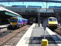 TransPennine Express 185122 departs Waverley west end platform 13 on the 12.11 service to Manchester Airport via Carlisle as 91002 rests at platform 11 after arrival some 5 minutes earlier on the 07.30 ex Kings Cross East Coast service. <br><br>[David Pesterfield&nbsp;04/06/2013]