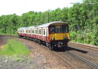 An Airdrie bound service approaching Hyndland during the afternoon of 6th June 2013.<br><br>[John Steven&nbsp;06/06/2013]