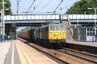 One of the occasions on which Freightliner Class 86s make a daylight appearance on the WCML in Lancashire is the Saturday lunchtime Coatbridge to Crewe service. On 8 June 2013 86627 double heads another member of the class on the Up slow line at Leyland.<br><br>[John McIntyre&nbsp;08/06/2013]
