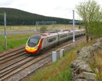 A northbound Pendolino passes Beattock Summit and the road traffic on the M74 behind it (in more ways than one!) on 03 June 2013.<br><br>[John McIntyre 03/06/2013]