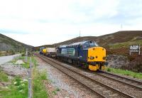 DRS liveried 37608 and 37259 take a nuclear flask wagon past Slochd Summit on the way to Georgemas Junction.<br><br>[John Gray&nbsp;13/06/2013]