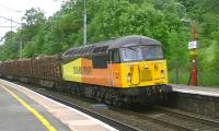 Colas Railfreight 56087 heads south through Oxenholme on 15 June with a Carlisle Yard to Chirk Kronospan log train.<br><br>[Ken Browne&nbsp;15/06/2013]