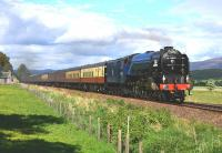 Painted in early B.R.Express Passenger Blue, A1 Pacific No 60163 Tornado hauls the <I>Cathedrals Express</I> south on 15 June passing Balavil Cottage near Kingussie.<br><br>[John Gray&nbsp;15/06/2013]