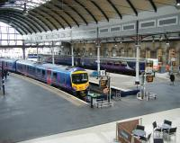 The west end of Newcastle Central on 12 June, with a TransPennine 185 service for Manchester Airport at platform 9 and a Northern DMU for Carlisle boarding at platform 12. <br><br>[Veronica Clibbery&nbsp;12/6/2013]