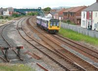 The 12.30 Northern Trains Saltburn - Darlington service runs parallel with Birdsall Row on the eastern approach to Redcar Central on 5 June 2013. The edge of The North Yorkshire Moors can be seen beyond the rooftops.<br><br>[John Furnevel&nbsp;05/06/2013]