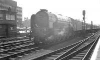 A1 Pacific no 60157 <I>Great Eastern</I> coming out of the sun and about to run through Doncaster station on the centre road on 31 May 1963. The train is the 7.51am Holloway sidings - Edinburgh Waverley <I>Anglo Scottish Car Carrier</I>, which would later become part of the BR <I>Motorail</I> service launched in 1966.<br><br>[K A Gray&nbsp;31/05/1963]