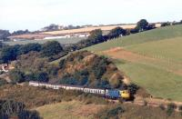 The 11.10 from Barnstaple to Waterloo photographed near Coleford Junction in the 1980s.<br><br>[Ian Dinmore&nbsp;//]