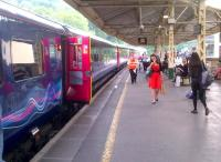 I don't know the lady in the red dress with the ice cream, but she sets off the blues on the HST nicely.  Oh yes...  the train boarding at Bath Spa is the 18.13 to Paddington see image [[43410]].<br><br>[Ken Strachan 31/05/2013]