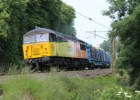 Colas Freight 56302 (formerly 56124) powers the Carlisle to Chirk log train up the gradient to the south of Lancaster station on 26th June 2013.<br><br>[Mark Bartlett&nbsp;26/06/2013]
